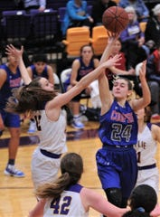 Cooper's Meri Tetaj (24) shoots over Wylie's Karis Christian (12) and Bailey Roberts (42). Wylie won the District 4-5A game 76-37 on Tuesday, Jan. 8, 2019, at Bulldog Gym.
