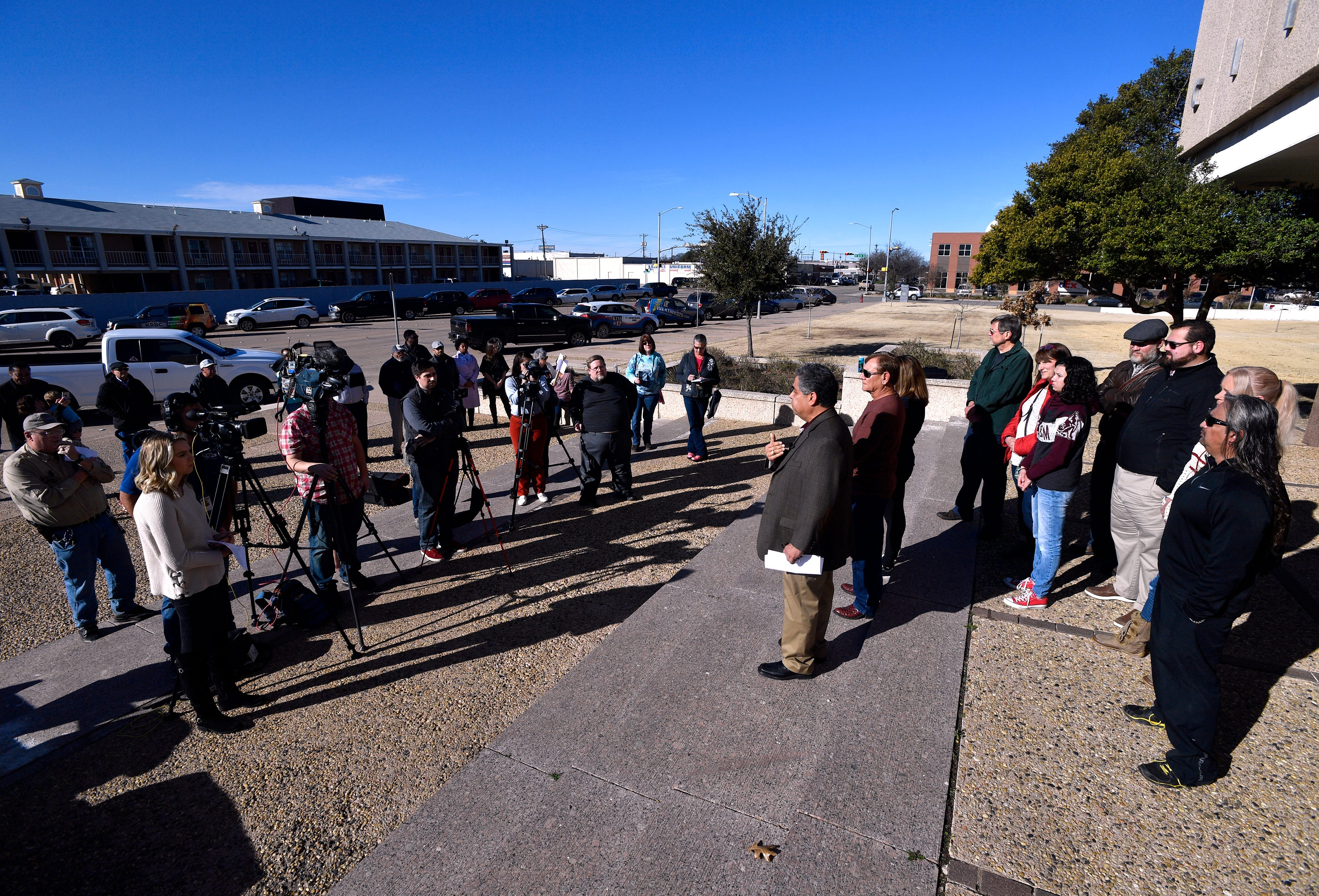 Abilene Independent School District board member Samuel Garcia others speak to reporters Wednesday regarding city councilman Kyle McAlister's social media statements. The group stood in front of Abilene City Hall to protest McAlister's past postings that the group labeled as racist.