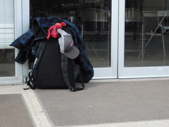 A backpack outside City Light Ministries, which serves the homeless in Abilene.
