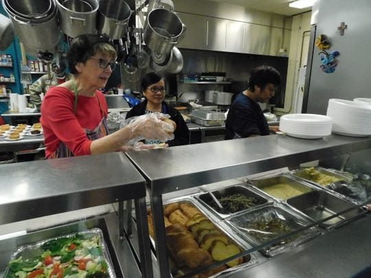 From left: Pearl Gray, Maura dela Cruz and Olga Gaona in the kitchen at City Light Community Ministries.