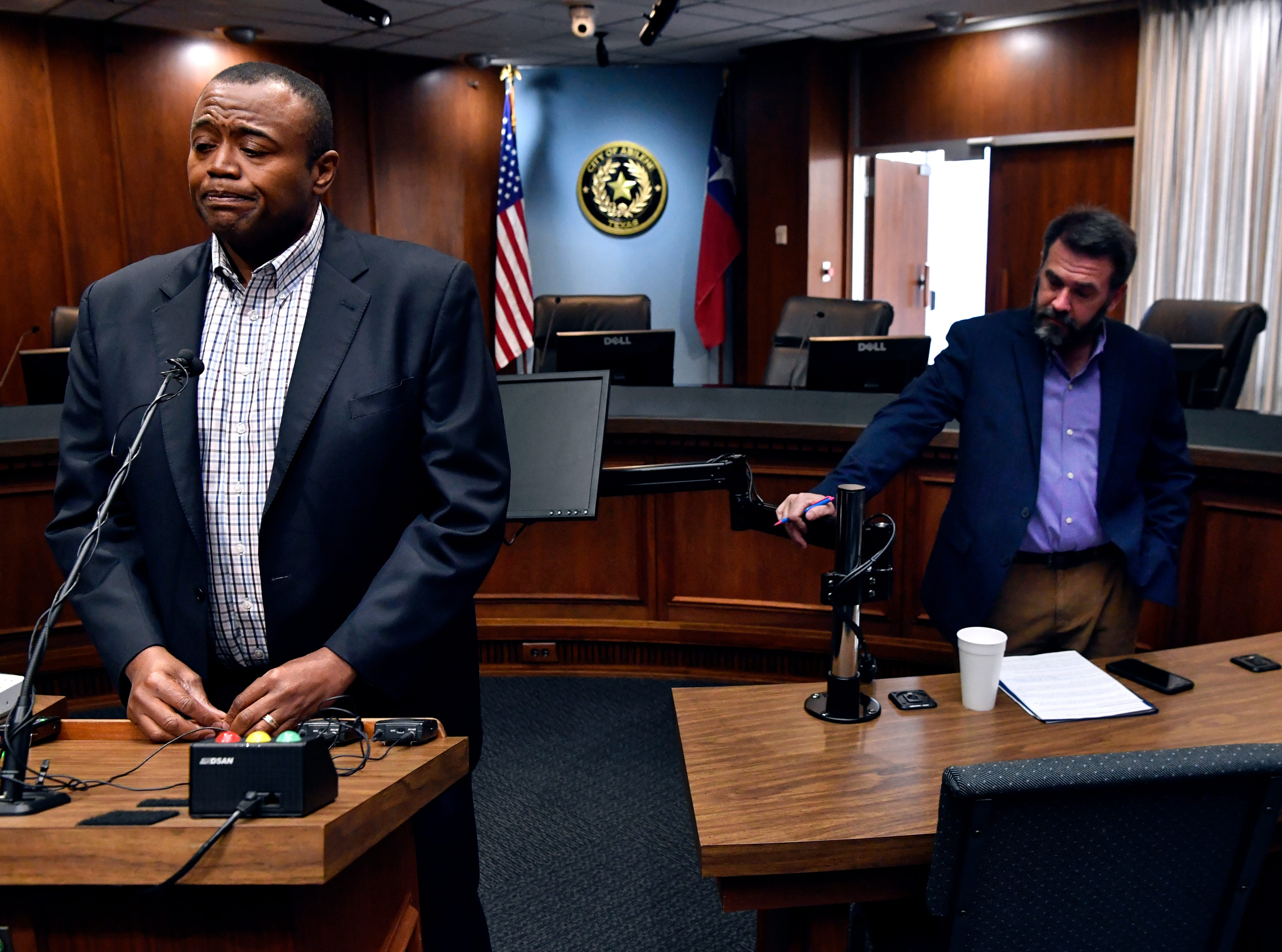 Abilene Mayor Anthony Williams addresses media Wednesday  as Councilman Kyle McAlister waits behind him. McAlister has been accused of racism based on passed social media postings which he characterized as poor attempts at humor. McAlister said he did not intend to step down but would vote for his own censure.