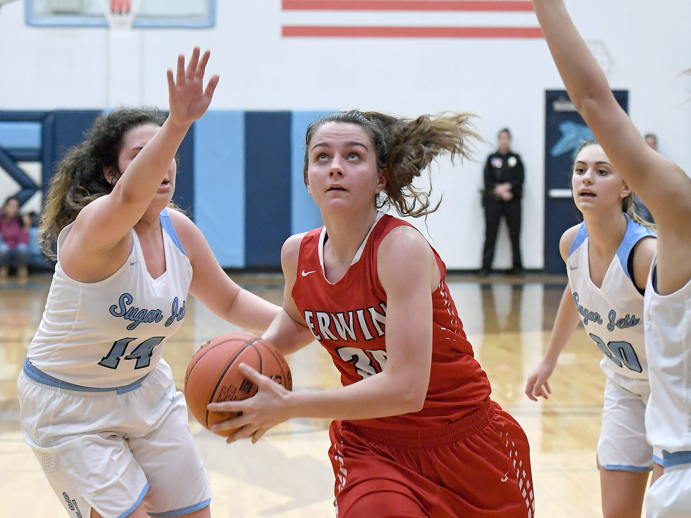 Erwin's Kaitlyn Messer charges toward the net against Enka during their game at Enka High School on Jan. 8, 2019. The Lady Warriors defeated the Sugar Jets 61-45.
