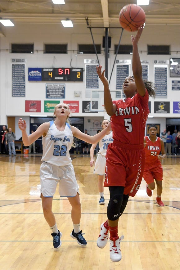 Erwin's Jaia Wilson goes up for a shot ahead of Enka's Mya Smith during their game at Enka High School on Jan. 8, 2019. The Lady Warriors defeated the Sugar Jets 61-45.