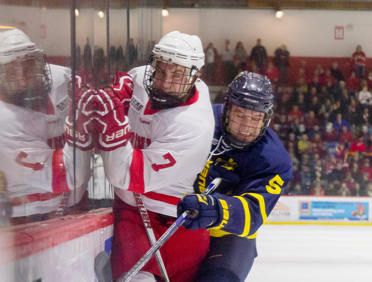2016: Cornell junior forward Jake Weidner tussles for position along the boards during the third period of Cornell's 5-2 win over Merrimack at Lynah Rink on Saturday, January 9.