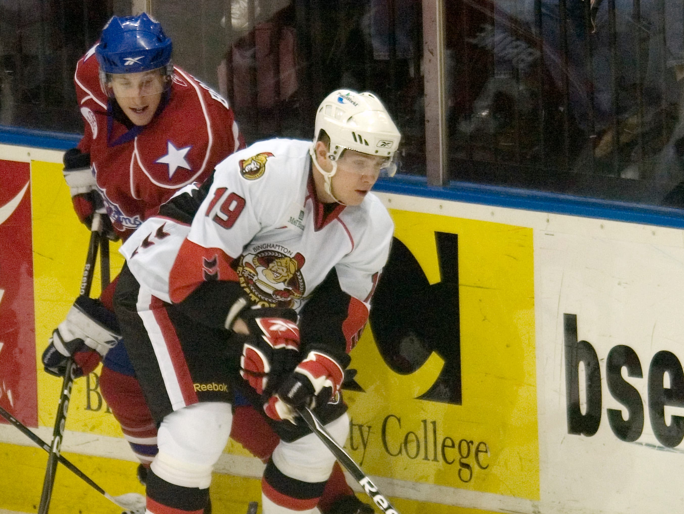 2009: Binghamton Senators' Zack Smith, right, is defended by Rochester Americans' David Brine in the first period of Saturday's game at Broome County Veterans Memorial Arena.