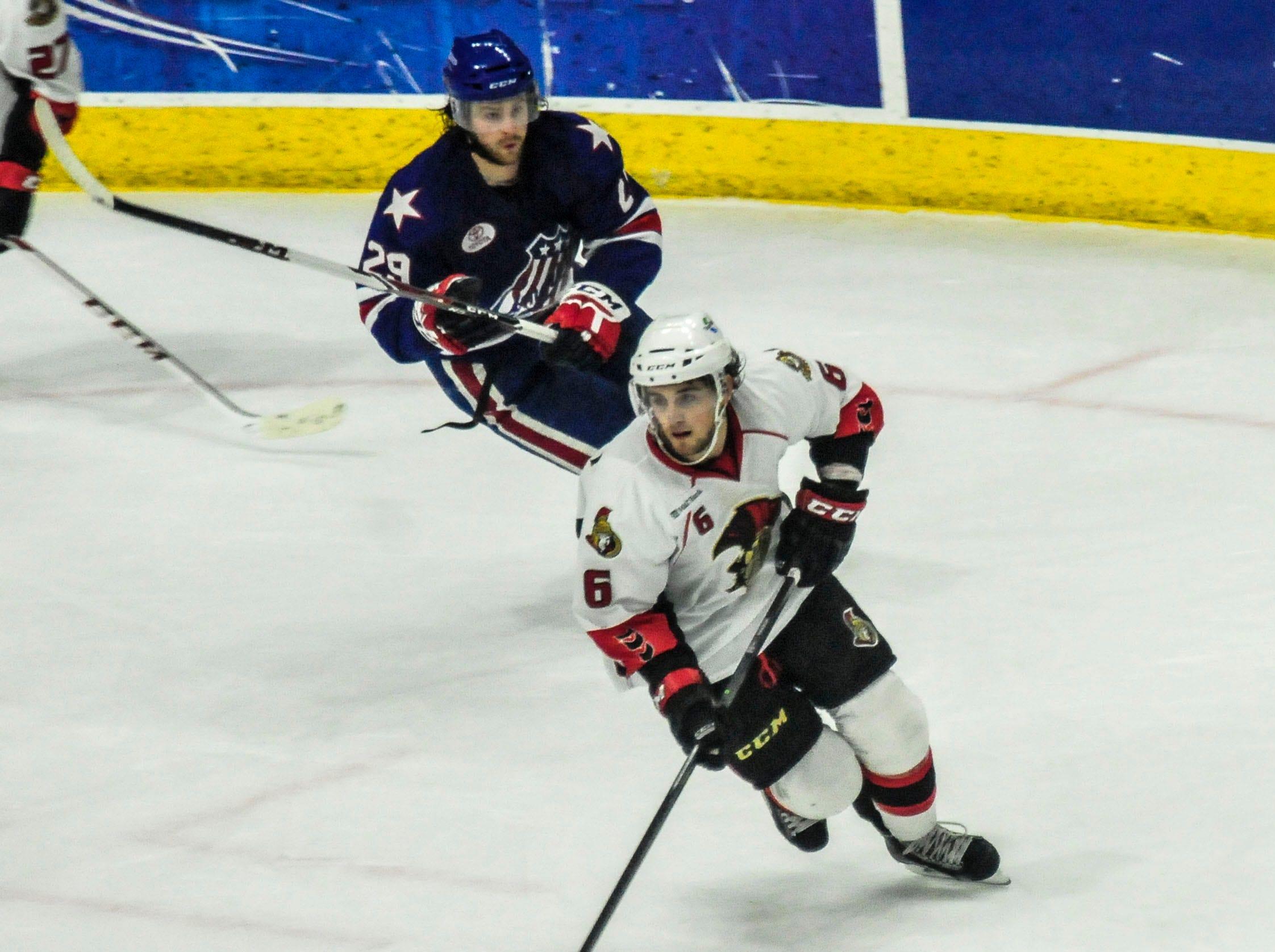 2014: BinghamtonÕs Chris Wideman skates past RochesterÕs Alex Hutchings during Saturday nightÕs hockey game at Broome County Veterans Memorial Arena.