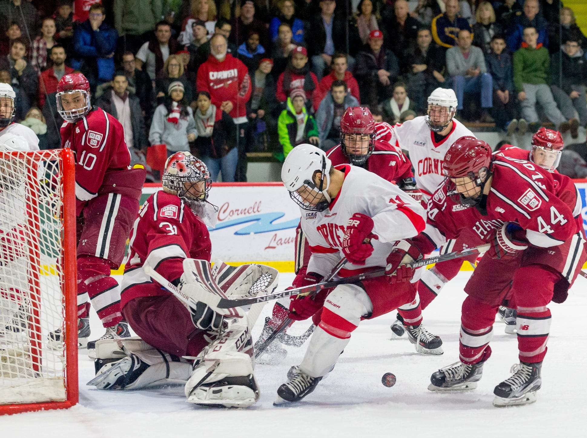 2016: Harvard goalie Merrick Madsen watches the puck as Cornell's Eric Freschi, center and Harvard's Michael Floodstrand try to control it in the closing minutes of Cornell's 6-2 loss Saturday evening at Lynah Rink.