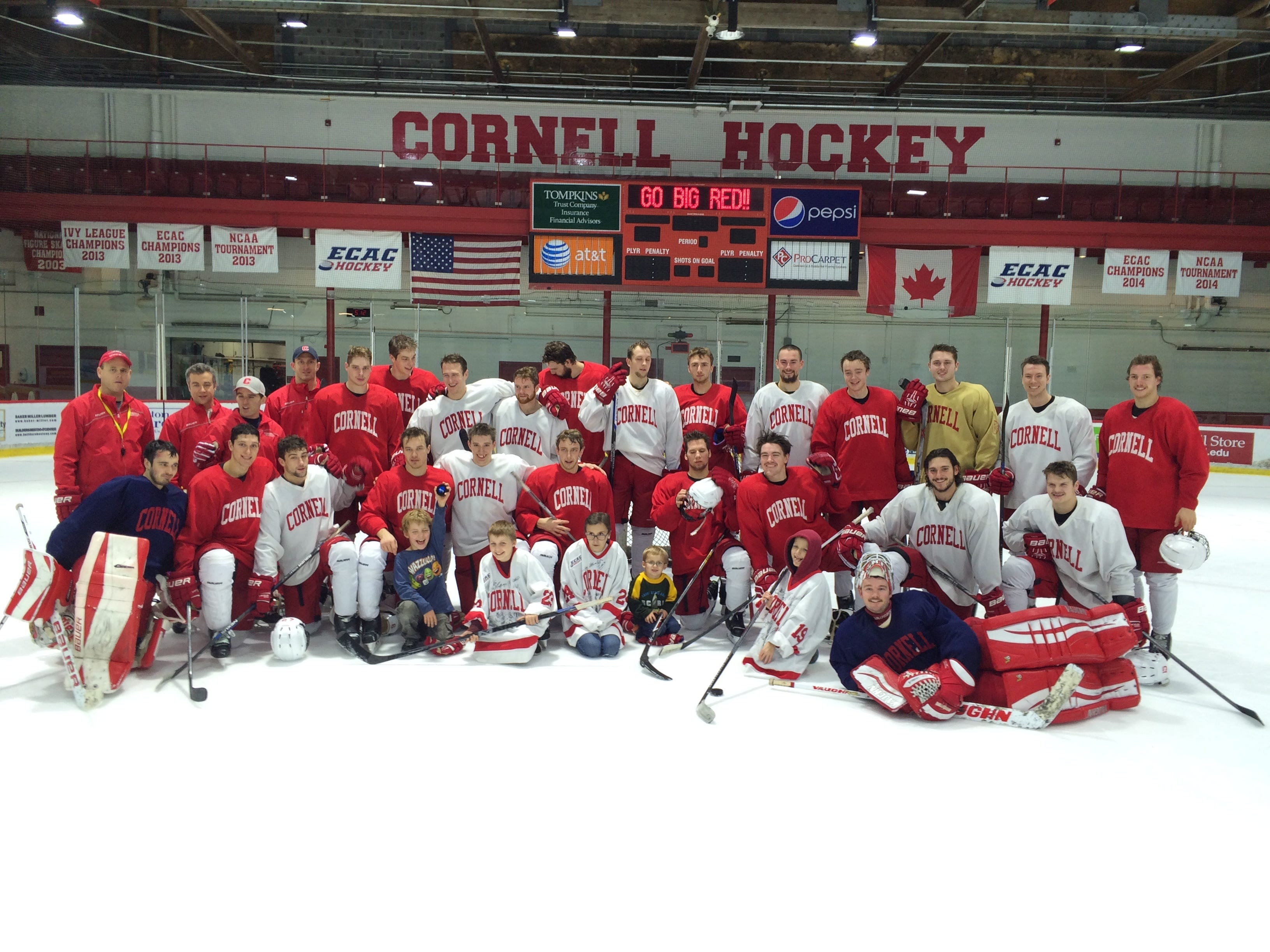 2015: The Cornell University men's hockey team takes a group photo with youths from Camp Good Days at Lynah Rink on Tuesday, Nov. 10, 2015.
