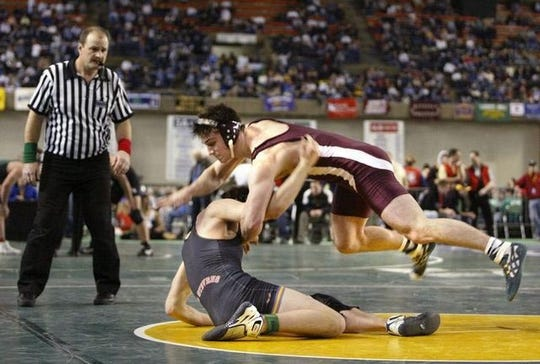 Brent Chriswell of South Kitsap attacks Jon Wilbourne of Lake Stevens during a 2006 preliminary-round match at Mat Classic at the Tacoma Dome. Chriswell will be inducted into the Kitsap Sports Hall of Fame later this month.