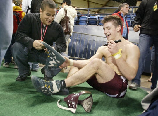 Brent Chriswell of South Kitsap autographed his wrestling shoes for a friend after winning his second state wrestling championship.