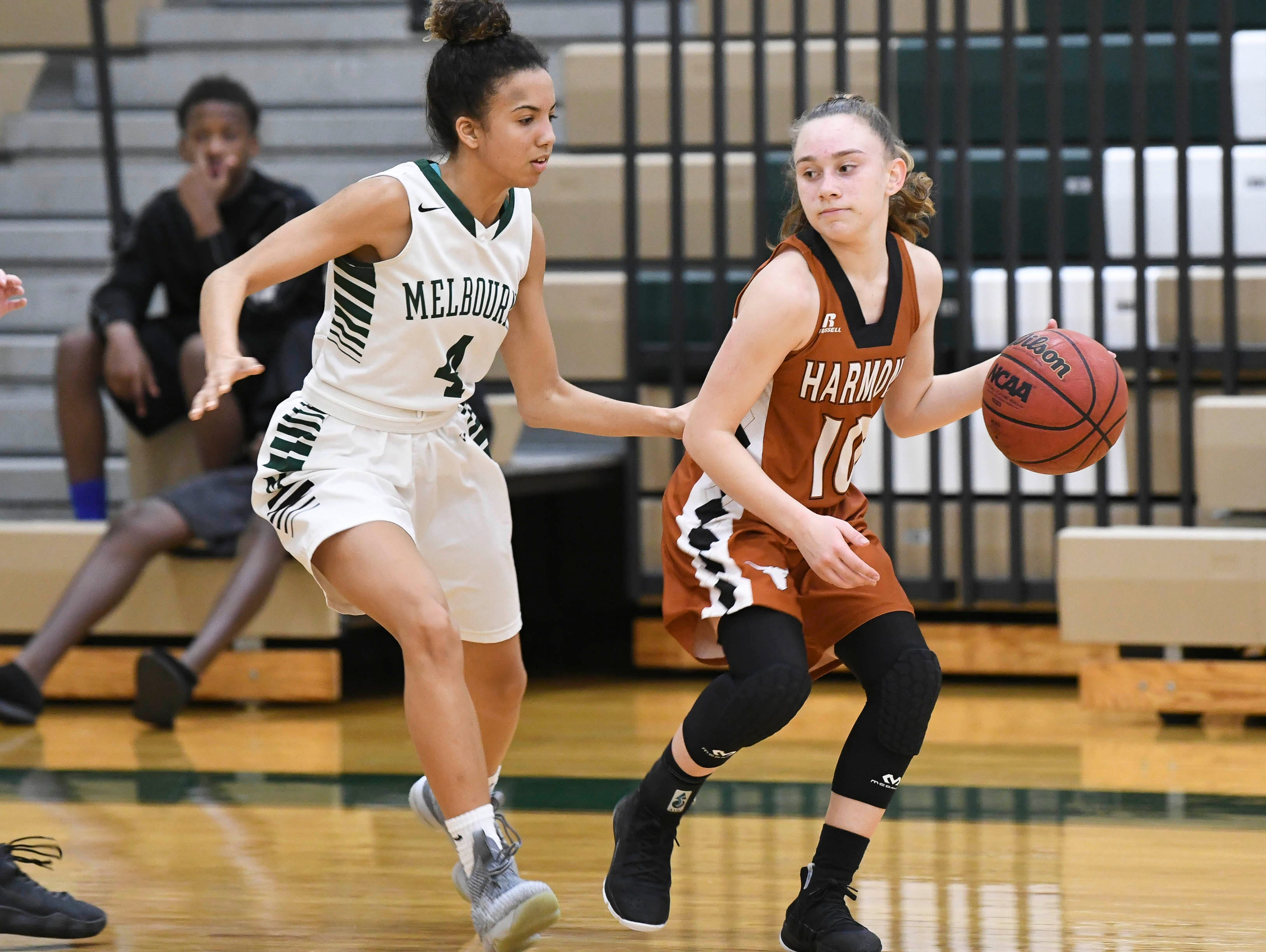 Melbourne's Jayla Charles guards Carlee Fitzgerald of Harmony during their game Tuesday.