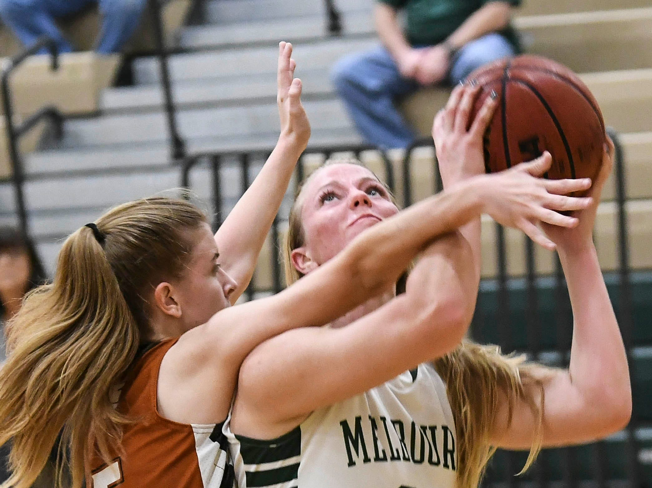 Morgan Matheny of Harmony fouls Ava Rowell of Melbourne during Tuesday's game in Melbourne.