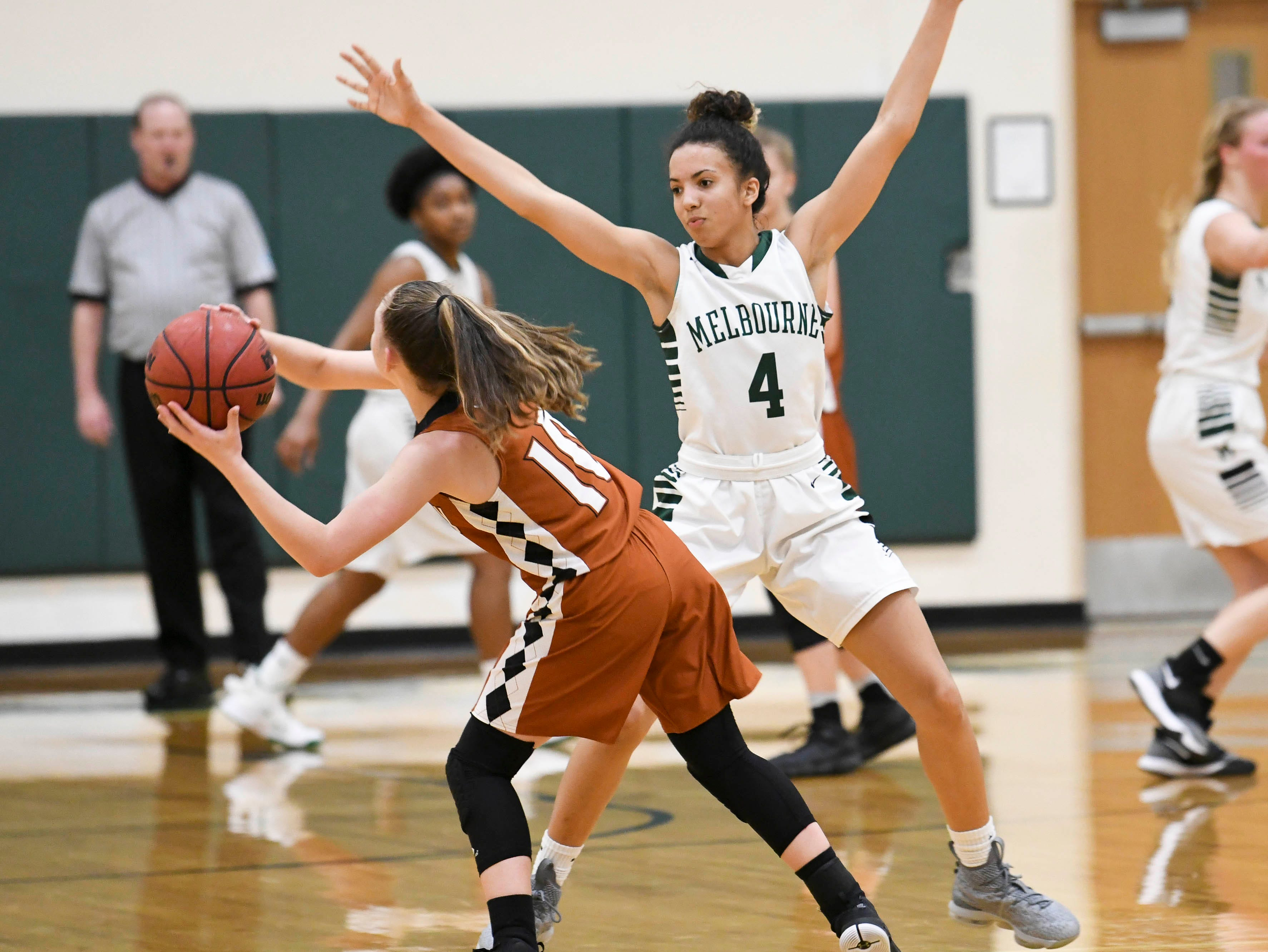 Melbourne's Jayla Charles guards Carlee Fitzgerald of Harmony during Tuesday's game in Melbourne.