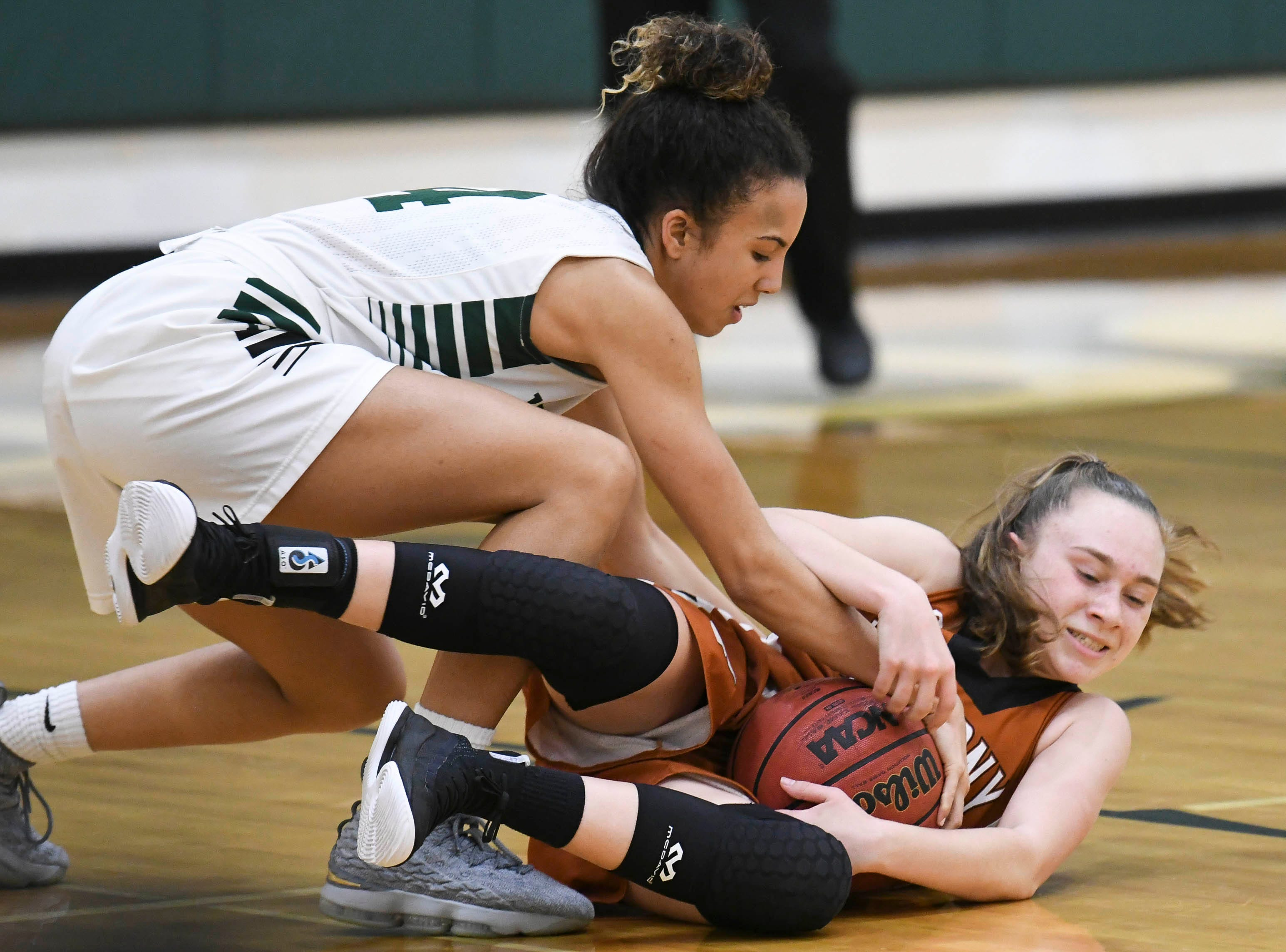 Melbourne's Jayla Charles fights for the ball with Carlee Fitzgerald during Tuesday's game at Melbourne High.