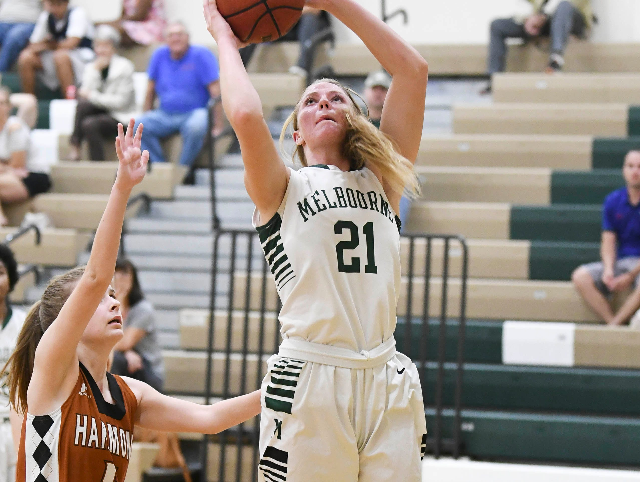 Melbourne's Ava Russell shoots over the guard of Ty Green of Harmony during Tuesday's game.