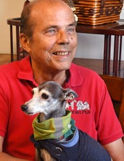 Bill Jacobson, seen here with his 17 year old Italian greyhound, Miko, is the owner of Puppies Plus, an independent pet store in Melbourne for over 21 years. He says that his puppies undergo various health exams, and that he uses only USDA licensed breeders with no violations.