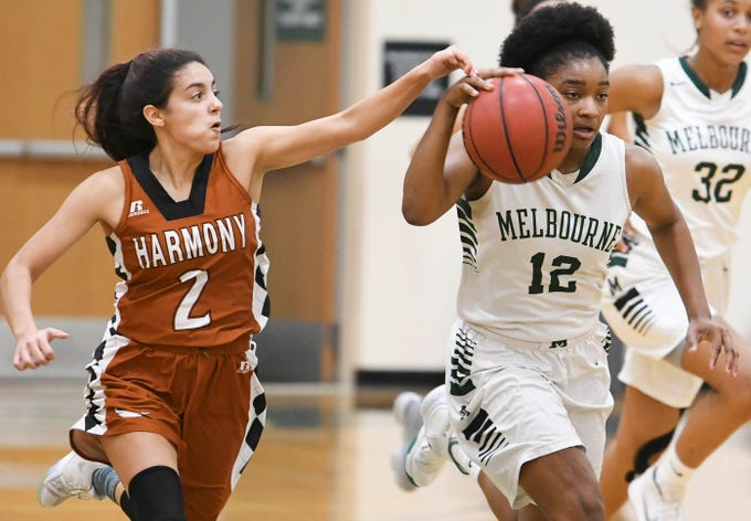 Andrea Santiago tries to steal the ball from Mikyla Tolivert of Melbourne during Tuesday's game .