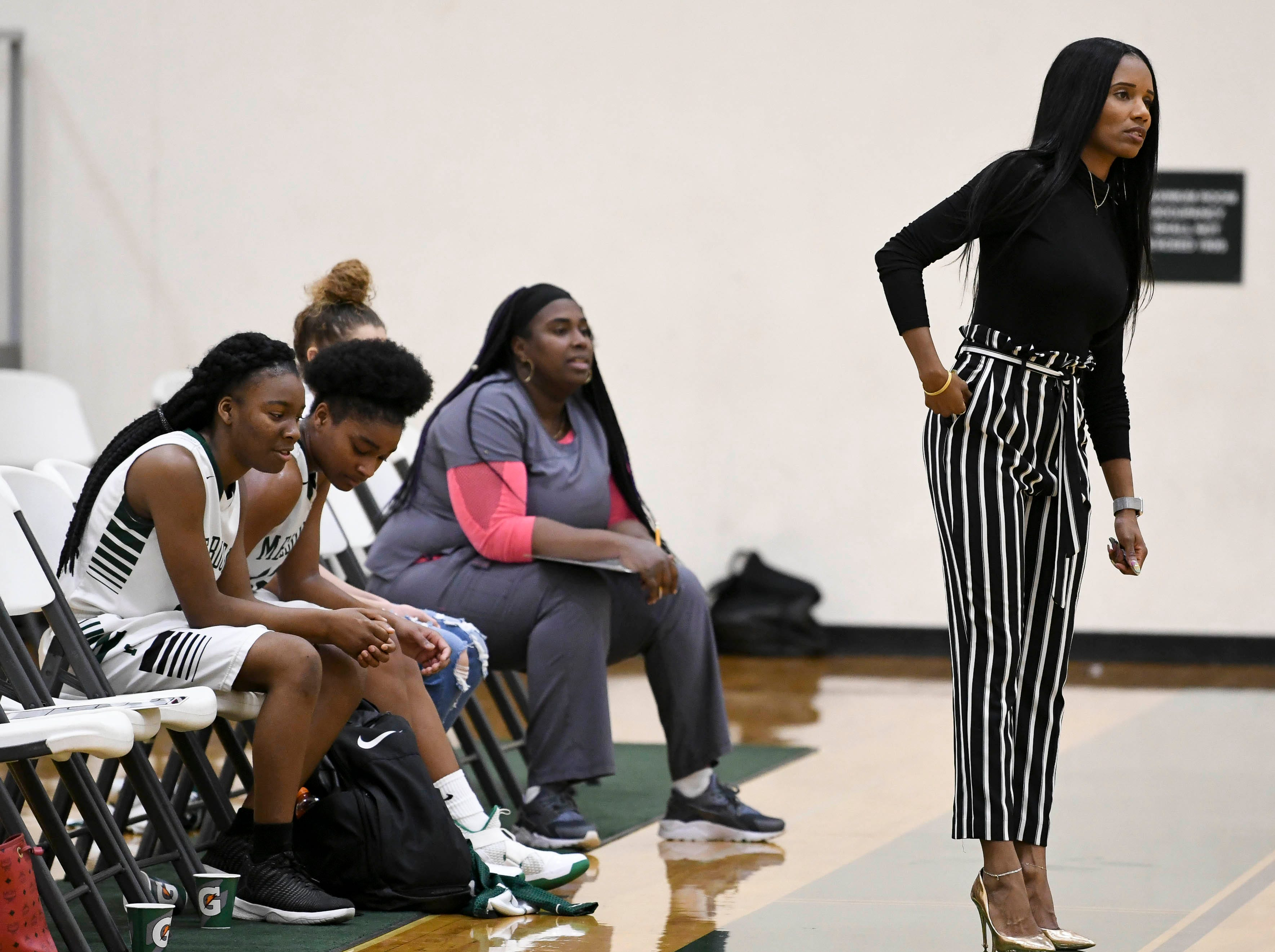 Melbourne girls basketball coach Aerial Wilson watches the action during Tuesday's game.