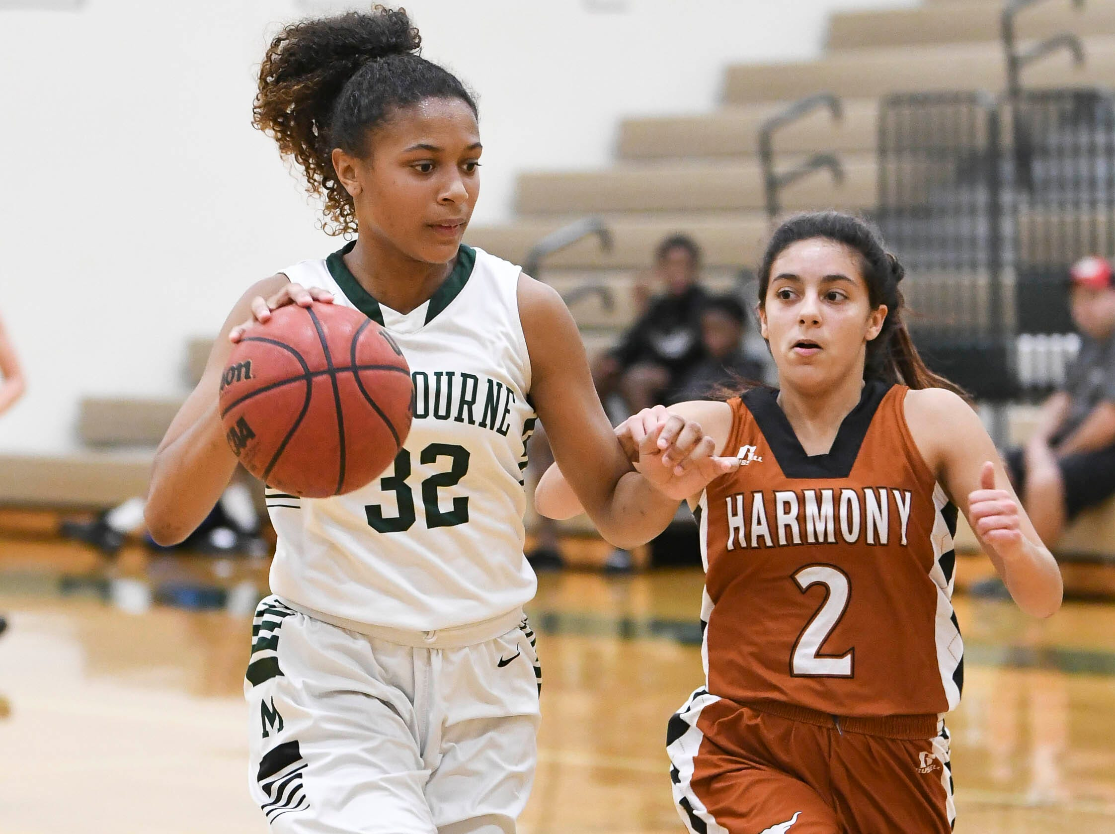 Melbourne's Makayla Morin drives to the basket past Andrea Santiago of Heritage during Tuesday's game at Melbourne High.