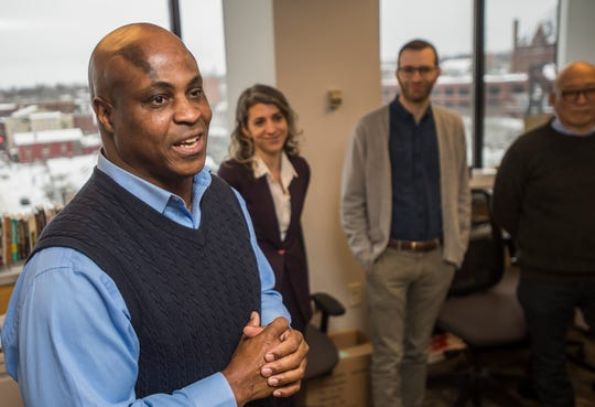 Left, Northeast Regional Editor for the USA Today Network and Executive Editor of the Asbury Park Press Hollis Towns congratulates newly appointed Burlington Free Press Executive Editor Emilie Stigliani and her leadership team; Digital Innovation Editor Evan Weiss and Insights and Engagement Editor Aki Soga during an announcement in Burlington on Wednesday, Jan. 9. 2019.
