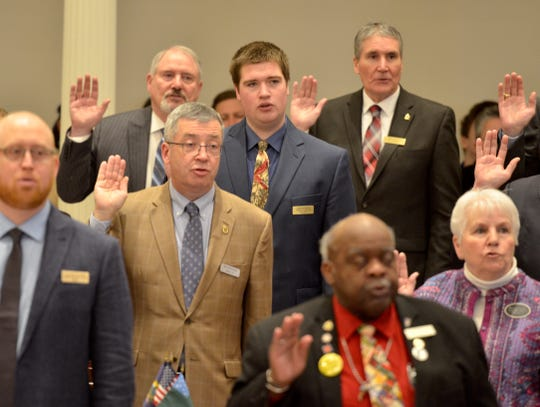 Rep. Patrick Seymour, R-Sutton, in blue, takes the oath of office in Montpelier on Jan. 9, 2019, becoming the youngest member of the Vermont House of Representatives.