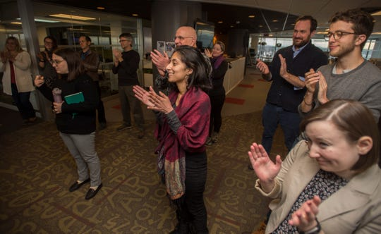 Burlington Free Press staffers congratulate newly appointed Executive Editor Emilie Stigliani and her leadership team; Digital Innovation Editor Evan Weiss and Insights and Engagement Editor Aki Soga, during an announcement made Wednesday, Jan. 9, 2019.