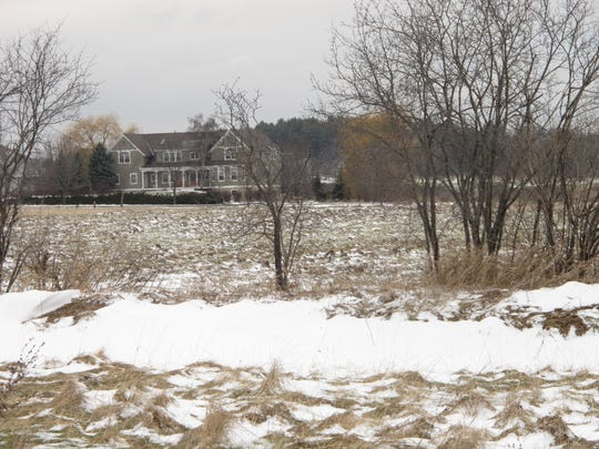 "A large house on Nowland Farm Road in South Burlington overlooks a hay field proposed for 150 housing units: ""Dorset Meadows,"" as seen on Jan. 8, 2019."