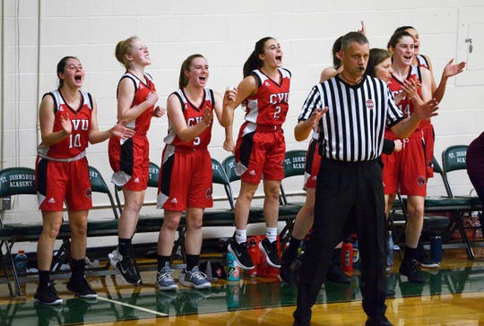 The Champlain Valley Union bench reacts to a Harper Mead 3-pointer in the fourth quarter of a 49-40 win at St. Johnsbury Academy on Tuesday, Jan. 8.