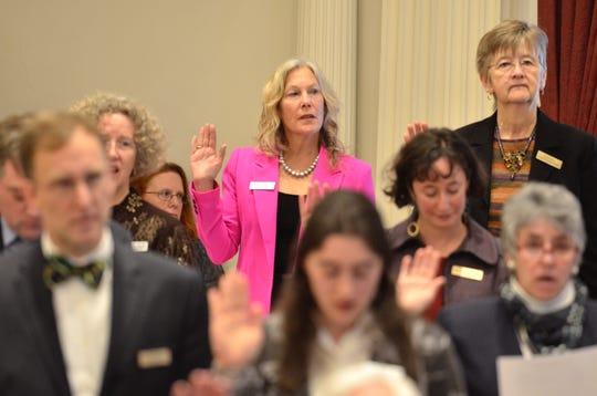 Rep. Maxine Grad, D-Moretown, takes the oath of office at the Statehouse in Montpelier on Jan. 9, 2019. Grad is chairwoman of the House Judiciary Committee.
