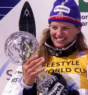 American Ann Battelle holds her trophy after the women's single Moguls freestyle World Cup in Livigno, northern Italy, Wednesday, March 15, 2000. She won the World Cup title in this speciality.