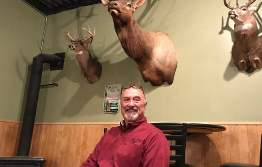 Randy Longe at Champlain Lanes in Shelburne, Vermont, with family trophies behind him on Jan. 8, 2019. The lanes will close on May 15, 2019 after 55  years and three generations.