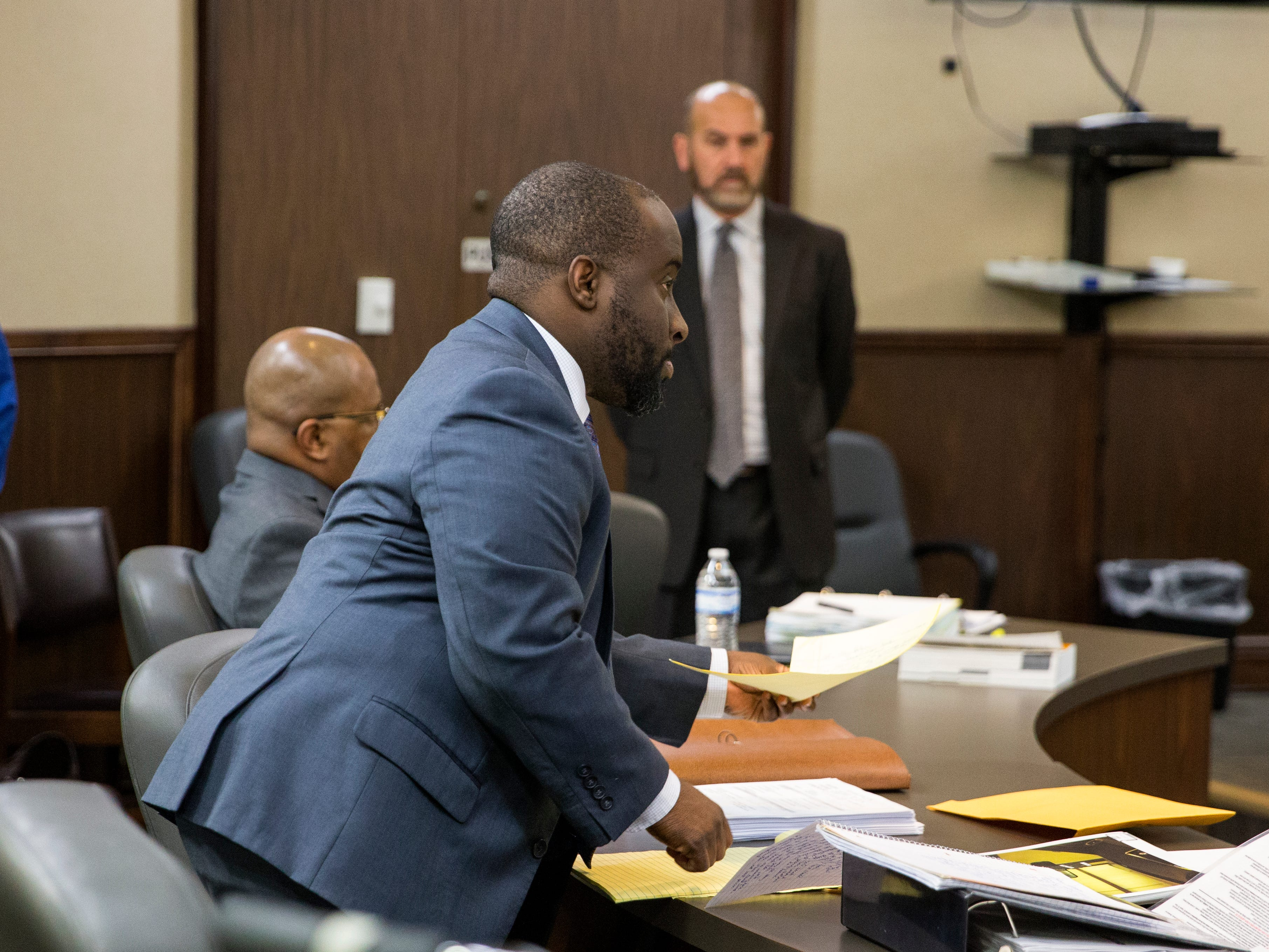 Prosecutor Matt Manning (center) prepares for opening statements in the trial of Elton Wayne Holmes waits for opening statements to begin in the 117th District Court on Tuesday, January 9, 2018. Holmes is charged with accident involving death, accident involving serious bodily injury, aggravated assault causing serious bodily injury and manslaughter in an alleged hit-and-run that left Rai-ane Garza, a King High School student dead.