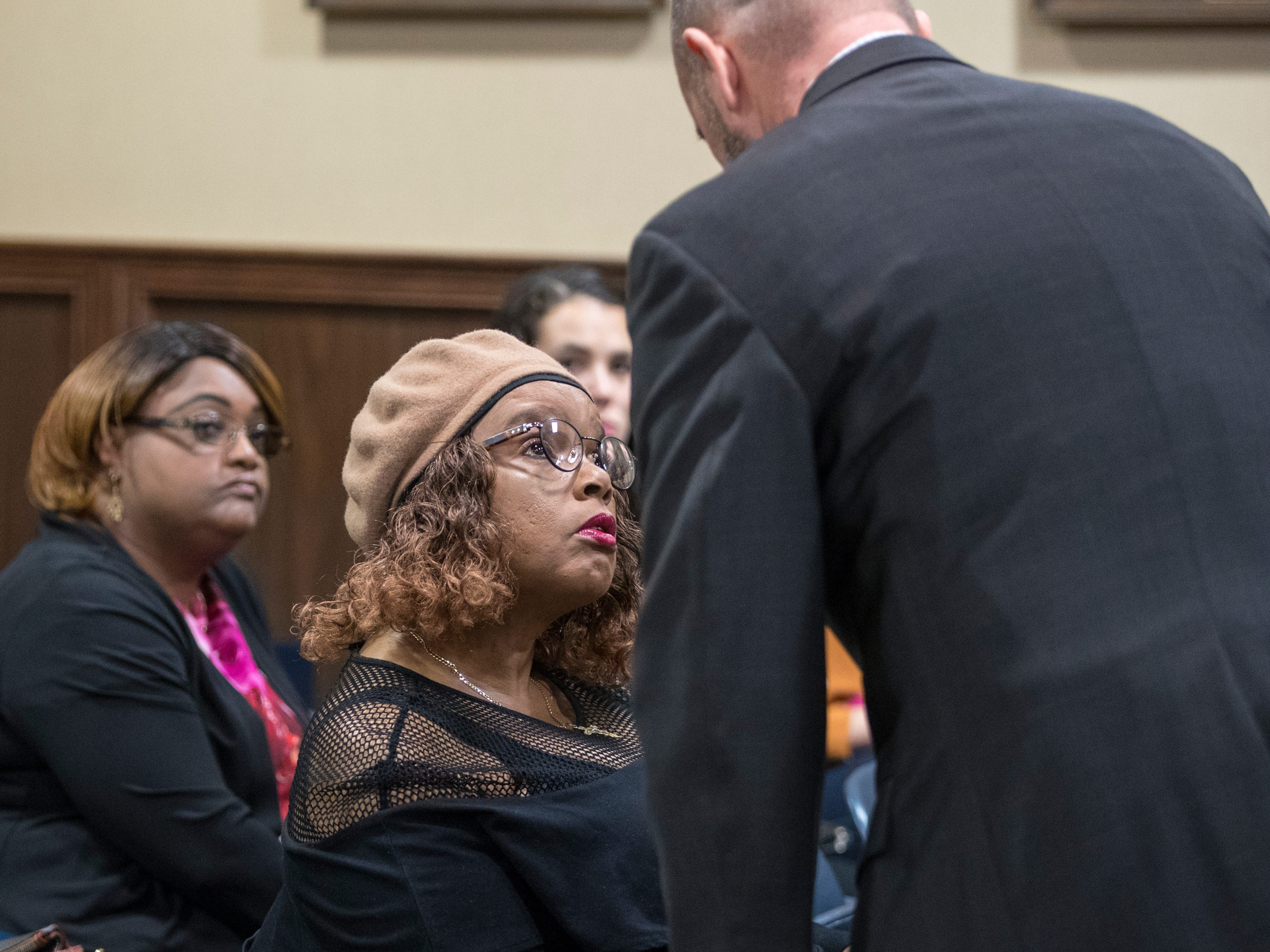 Lena Holmes, the mother of Elton Wayne Holmes, talks with defense attorney Scott Ellison before opening statements begin in the 117th District Court on Tuesday, January 9, 2018. Elton Wayne Holmes is charged with accident involving death, accident involving serious bodily injury, aggravated assault causing serious bodily injury and manslaughter in an alleged hit-and-run that left Rai-ane Garza, a King High School student dead.