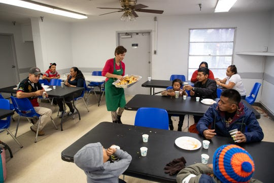 Food is handed out to migrants at one of the Catholic Charities of the Rio Grande Valley facilities in McAllen, Tx, on Wednesday, Jan. 9, 2019.