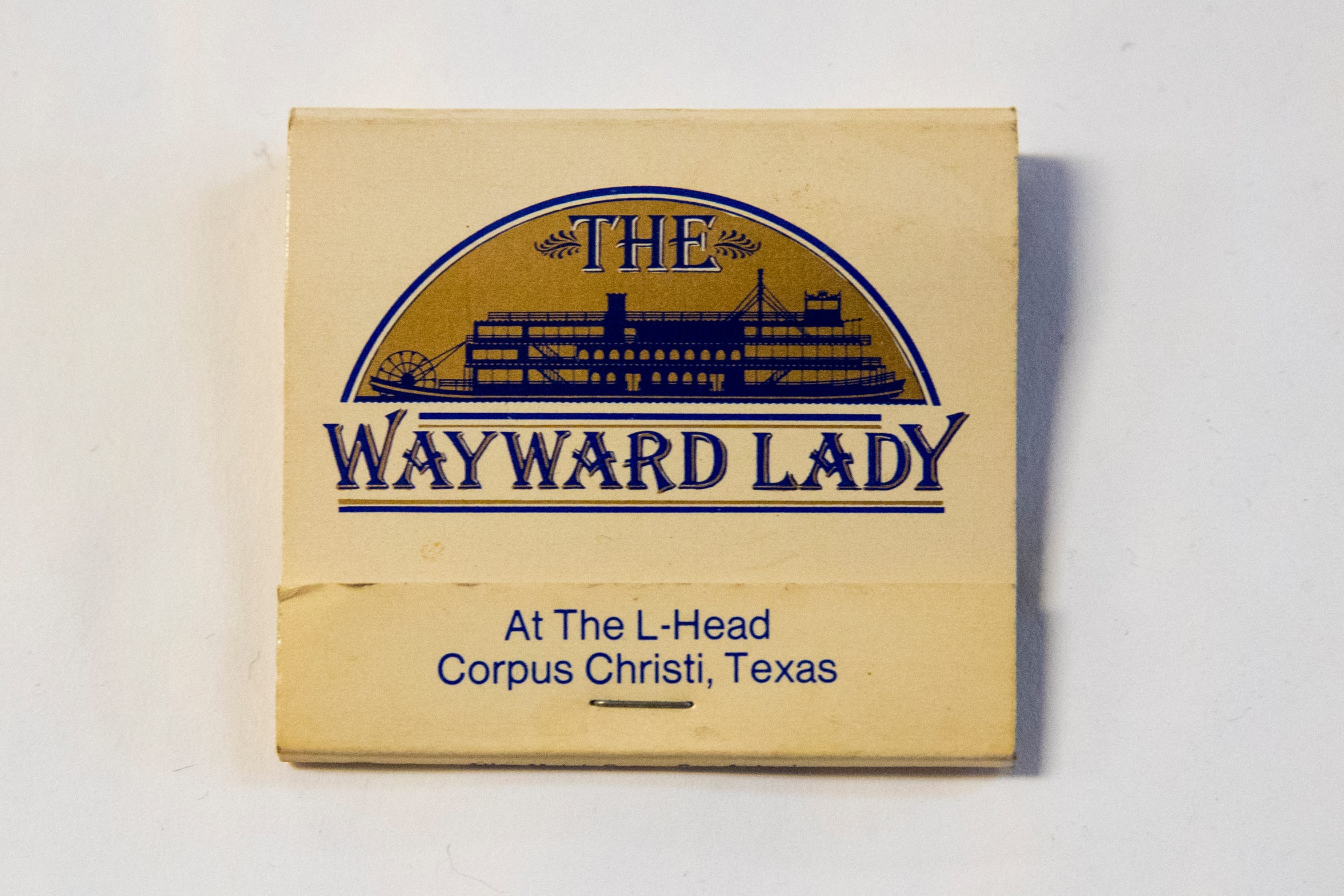 The Wayward Lady was a floating restaurant designed to look like a riverboat. It was docked at the Coopers Alley L-Head on the Corpus Christi Marina in the 1980s.