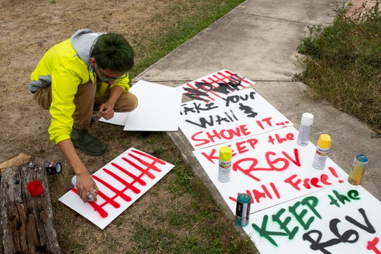 Activists against President Donald Trump's planned border wall make signs in San Juan, Tx, on Wednesday, Jan. 9, 2019, a day before Trump's visit to McAllen.
