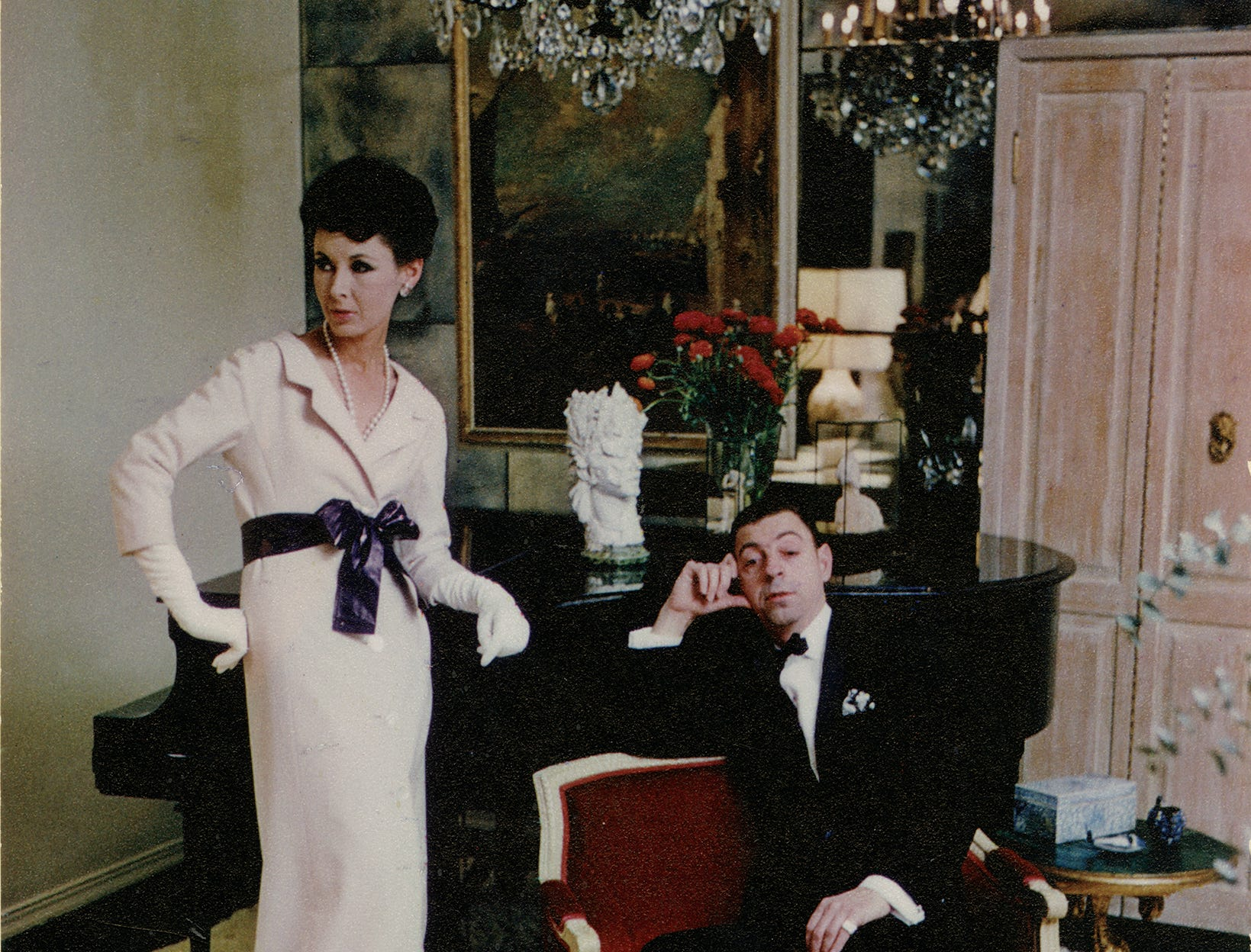 This is a portrait of James Galanos with model Pat Jones, circa 1960.