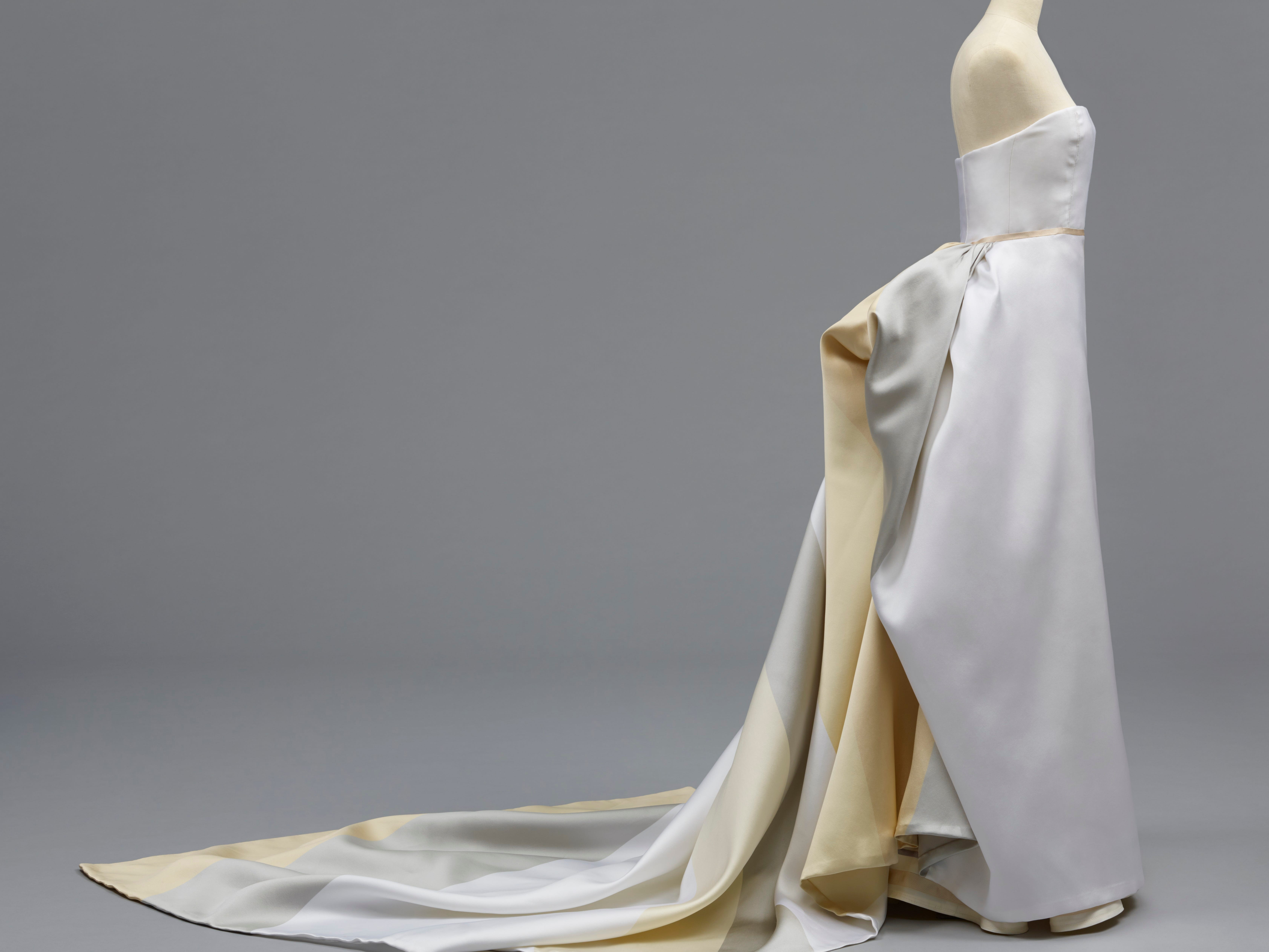 Designed by Carolina Herrera, this  'Woman's Wedding Dress' is from   Spring 2012. It is a   striped silk satin piece.