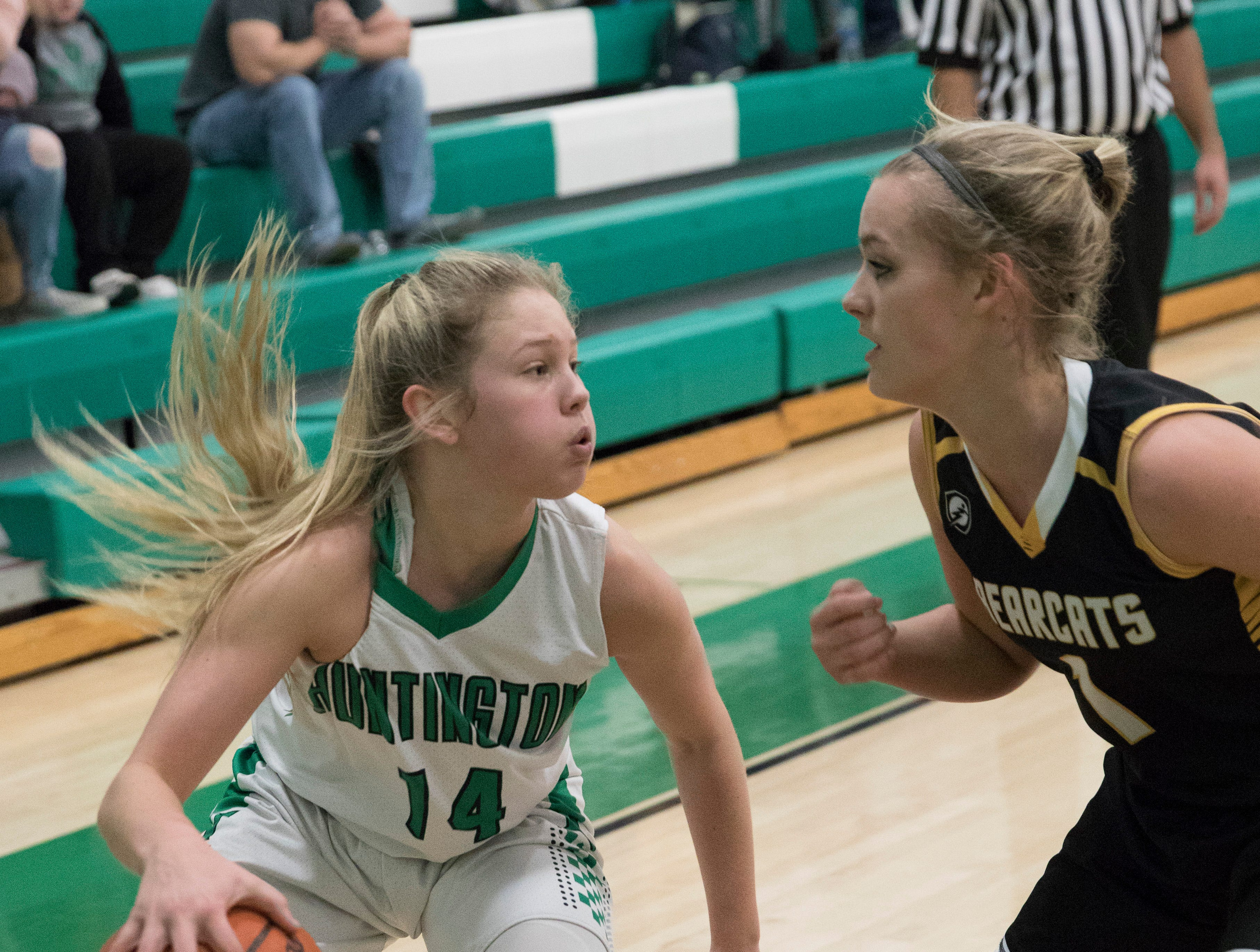 Huntington freshman Allison Bayse looks for an opening to pass Tuesday night against Paint Valley at Huntington High School. Huntington defeated Paint Valley 68-51.