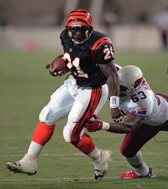 Arizona Cardinals Michael Bankston leg tackles Cincinnati Bengals Eric Bieniemy in the second quarter of their NFL exhibition game in Tempe, Ariz. Saturday Aug. 10, 1996.