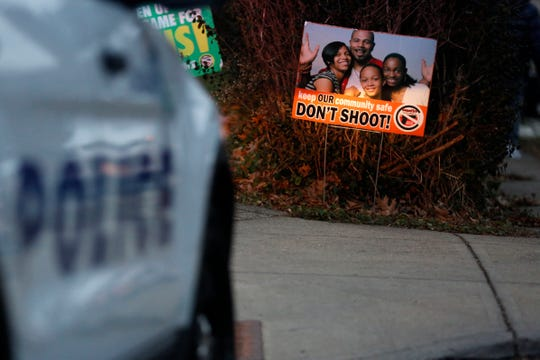 A sign calling for an end to gun violence is posted near the scene of a shooting at 3303 Perkins Ave. in the Avondale neighborhood of Cincinnati on Wednesday, Jan. 9, 2019. The 21-year-old victim was taken to UC Medical Center with life-threatening wounds, according to police.