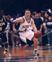 Pat Kelsey takes the ball up the court in his playing days for Xavier University.