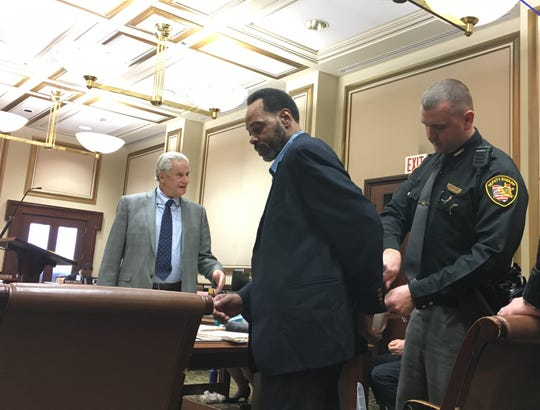Thomas Walker is led into Hamilton County Common Pleas Judge Tom Heekin's courtroom Wednesday before jury selection. Walker is standing trial on charges including murder, felonious assault and abuse of a corpse in the 2016 killing of his girlfriend, Necole Craig.
