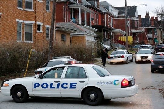 Police close off the street at the scene of a shooting at 3303 Perkins Ave. in the Avondale neighborhood of Cincinnati on Wednesday, Jan. 9, 2019. The 21-year-old victim was taken to UC Medical Center with life-threatening wounds, according to police.
