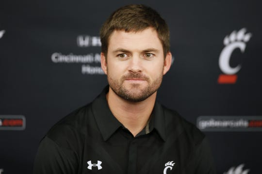 Cincinnati Bearcats offensive coordinator Zac Taylor, is introduced prior to the NCAA men's basketball game between the Tulane Green Wave and the Cincinnati Bearcats, Sunday, Jan. 24, 2016, at Fifth Third Arena in Cincinnati.