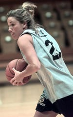 In practice action in 1999, Katie Kelsey looks for some one to pass the ball off to during drills at Northern Kentucky University. She won a state championship with Roger Bacon High School.