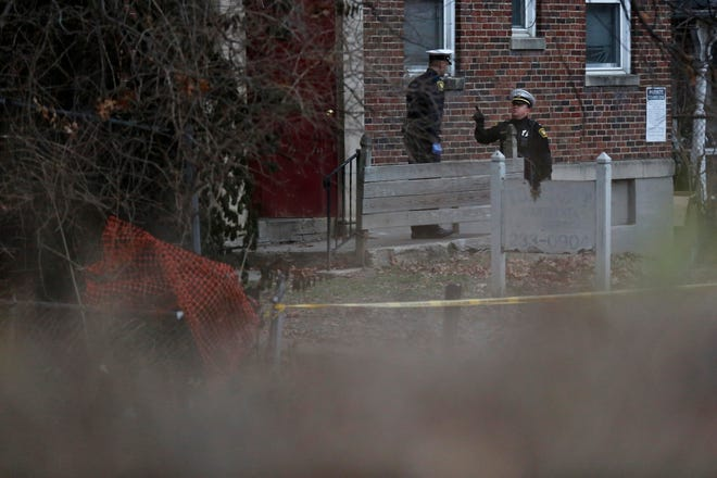 Police block the entrance of an apartment building at the scene of a shooting at 3303 Perkins Ave. in the Avondale neighborhood of Cincinnati on Wednesday, Jan. 9, 2019. The 21-year-old victim was taken to UC Medical Center with life-threatening wounds, according to police.
