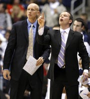 Former Xavier head coach Chris Mack looks on as his former associate coach Pat Kelsey yells instruction in a November 2009 game. They went from playing ball in the Kelseys' back yard to coaching on the sidelines at Xavier.