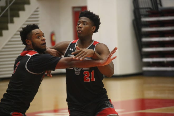 Austin Peay's Terry Taylor (21) tries to hold off teammate Chris Porter-Bunton during practice drills Tuesday at the Dunn Center.