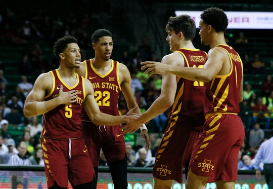 Iowa State Cyclones guard Lindell Wigginton (5) and guard Tyrese Haliburton (22) and forward Michael Jacobson (12) and guard Nick Weiler-Babb (1) huddle after a made basket against the Baylor Bears during the first half at Ferrell Center.
